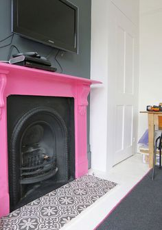 Ha ha love the pink fireplace a tiled hearth though?