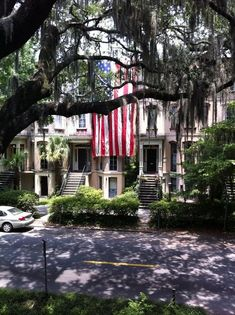 Beautiful Southern home framed with a live oak dripping with Spanish Moss in Savannah. GA