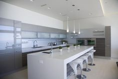 Poggenpohl kitchen with upper glossy cabinets and white countertops