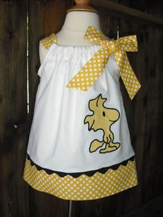 Charlie Brown Woodstock Bird Pillowcase dress-Oh my goodness, I love this for so many reasons! Peanuts, black and gold, adorable! Now to get the little girl to wear it...