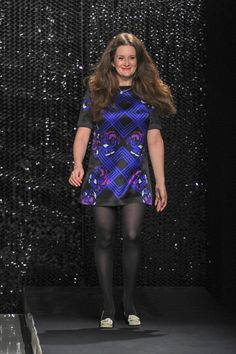 Giovanna Randall taking a bow after her fall/winter collection debute 2013