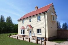 Detached house with HardiePlank cladding in woodland cream colour