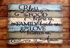 Family Prayer on reclaimed pallet wood board. Size: Item measures 26x18 Colors: The background is olive green, aqua and pale yellow. Lettering