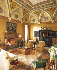 Traditional Living Room by Mlinaric, Henry and Zervudachi in Tuscan castle dating to the 11th Century
