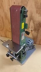 Belt Sander Motor Modification by DanLins -- I've owned this cheap Harbor Freight belt sander for 10 years, and it has always been under powered and slow. So, I replaced the 1/2 h.p. 1725 rpm motor with a 3/4 h.p. Craftsman 3450 rpm unit, and while I was working on it, decided to make a better fence (or table?)  Simple, adjustable and easy to make from stock laying around my shop.   This thing now has plenty of power and is quick to remove material.  Dan...