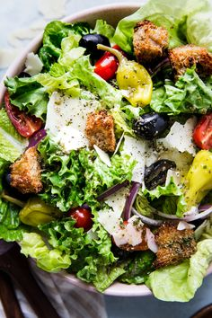 Simple Italian Salad with a delicious dressing! This recipe includes a few of our favorite ingredients such as romaine lettuce, Parmesan cheese black olives and plenty of Parmesan cheese! It's basically The Olive Garden Salad but way better!