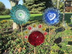 Yard art / garden Flowers created from antique glass plates and dishes.
