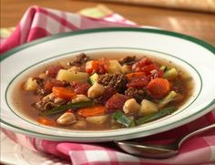 Slow Cooker Easy Italian Sausage-Vegetable Soup 1/2 lb. bulk Italian pork sausage 1 cup sliced fresh carrots 1 large baking potato, peeled, cut into 1/2-inch cubes 1 garlic clove, minced 2 (14-oz.) cans beef broth 1 (15-oz.) can garbanzo beans or chickpeas, drained 1 (14.5-oz.) can pasta-style chunky tomatoes, undrained 1 1/2 cups water 1/2 teaspoon dried Italian seasoning 1 bay leaf 1cup julienne-cut (2x1/8x1/8-inch) zucchini 1/4 cup grated fresh...  Please like, share or rein. Thanks!