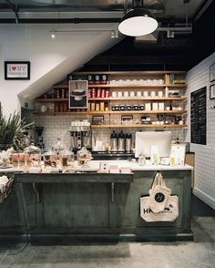 Bar Photo - White subway tile and open wooden shelving in a coffee bar