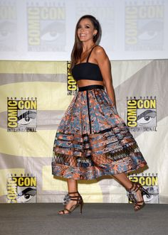 Jessica Alba loves to show off her toned tummy in crop tops and full skirts. Comic-Con was no exception, where she opted for a black bralette and printed satin midi with net panels.