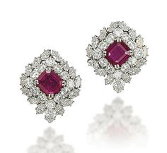 A PAIR OF RUBY AND DIAMOND EAR CLIPS, BY HARRY WINSTON  Each centering upon a cut-cornered rectangular-cut ruby in a brilliant-cut, pear- and marquise-shaped diamond surround, mounted in platinum and gold, 2.7 cm With maker's mark of Jacques Timey for Harry Winston