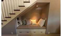 Reading and telephone seat under the staircase - very cute