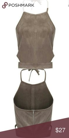 Faux suede crop top Back zip, halter style. Side cut out detail. Very soft faux suede material. Runs a little big for a small. Tops Crop Tops