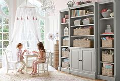 Playroom inspiration- so perfect! Pottery Barn Kids! Tall shelving system.