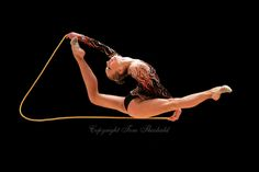 Inna Zhukova of Belarus (here split leap with rope) performed in all four apparatus finals in rhythmic gymnastics at World Games from Duisburg, Germany on July 20-21, 2005.  Event finals in rhythmic gymnastics are only held at World Games. (Photo by Tom Theobald)