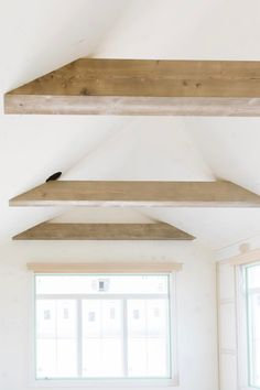 No doubt about it, ceilings are typically the most under utilized surfaces for styling when it comes to interiors, unless we're talking about more traditional architecture. Faux Ceiling Beams, Vaulted Ceiling Kitchen, Faux Wood Beams, Wooden Ceilings, Bedroom Ceiling, Barrel Ceiling, Angled Ceilings, Wood Arch, Exposed Beams