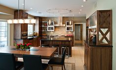 Take a look at my favorite #kitchen #design, just love how the wooden table fits in a modern style kitchen.