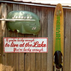 A Single Vintage Waterski and Vintage Boat Motor cover keep our sign company. Lucky Enough Rustic Sign| Lake and Beach Decor