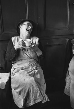 Photographed by Gerti Deutsch; a bedmaker enjoys a cup of tea at Cambridge University, England, UK, in Sipping Tea, Drinking Tea, Women In History, British History, Working Girl, Magazine Pictures, Cambridge University, Cuppa Tea, Photo Essay