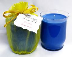 """The Cause Candle """"Autism Awareness""""  Sparkling Citrus  April Cause: Autism Awareness  Benefits: Autism Speaks  4.00 dollars from each candle benefits this month's cause  The Candle: 18oz Hurricane style container  Fragrance: Sparkling Citrus  Color: Bright Blue with Yellow organza bag    Our premium soy bean wax candles are made from two types of American-grown soybeans with natural botanical oils added to give them vibrant colors and a creamy texture."""