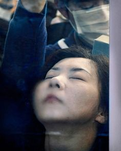 German photographerMichael Wolfventured in the dark depths of Tokyo's peak hour to photograph Japanese commuters and the uncomfortable routine they embark on each day. The trains are so congested, passengers are pressed flush against the glass, surrounded & drench in the sweat, breath and condensation of the other commuters in the carriage.