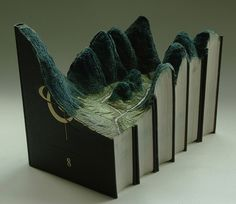 Landscapes carved from old books. I love re-purposed artwork.