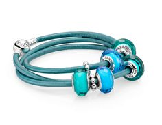 Go a bit tropical with blue and turquoise murano charms on a teal leather bracelet #PANDORAbracelet