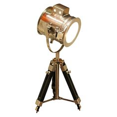 Channel nautical-chic style with the metallic beacon design of the Tripod Search Light Table Lamp from Fat Shack Vintage.