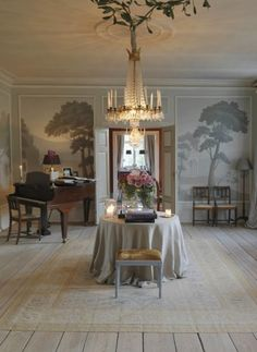Stunning chandelier, beautiful hand painted walls Norwegian interior designers