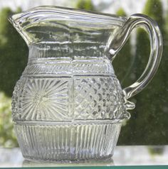 GIII.6 1/2 Pint Blown Three Mold Creamer   Clear flint glass, Blown 3 Mold,  Applied handle & pontil scarred base. Boston & Sandwich Glassworks Circa 1825  Blown in a 1/2 Pint decanter mold for pattern, Manipulated into a creamer w/ added handle. It appears that the very tip of the rigaree on the lower handle attachment may be chipped or just finished rough. This is the case with most examples, SOLD $235.-