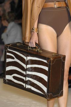 Hermès luggage.... Who knows why she's not dressed.