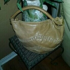 Franco Sarto handbag And brown leather like material  handbag that measure about 11 ins from top to bottom and about 13 ins from side to side has small sign of soil and wear no rips or tears in good used condition. Franco Sarto Bags Shoulder Bags