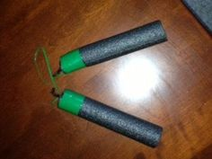 DIY foam Numchucks   What you need: 2 Nerf Bulletts 1 Piece of rope 1 Piece of wire  Instructions: 1. Cut the wire in half 2. Poke the wires in the bullets 3. Bend the wires in shape of a hook 4. Tie the rope on each hook