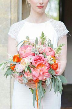 Coral Peonies, Pink Ranunculus, Pink Roses, Peach English Garden Roses, Pink Snapdragons, Orange Ranunculus, Red-Orange Ranunculus, Green Succulents, Green Seeded Eucalyptus Hand Tied Wedding Bouquet