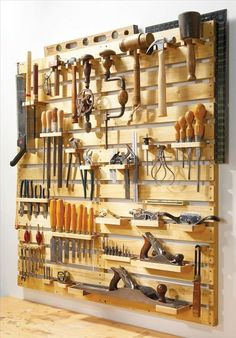 Look at this perfect tool rack organization. It was made from new wood in the link where we found it, but could easily be made out of pallets or with Rust-Oleum wood stain!:                                                                                                                                                                                 More