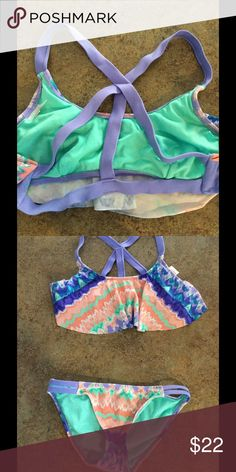 Tie dye pastel bikini with ruffle top Adorable. Pastel colors. Ruffle top. Cris cross detail on back. Top is xl bottom is m Xhilaration Swim Bikinis