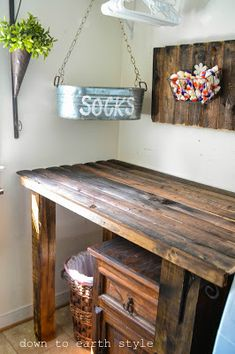 Down to Earth Style: Old Fence Features in the Laundry Room. LOVE that table and the matching one on the wall as well as the cool sock bucket. OK, I love everything!