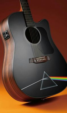 This is the cover art for the album The Dark Side of the Moon by the artist Pink Floyd. The cover art copyright is believed to belong to the label, Harvest / Capitol, or the graphic artist(s), Designed by Storm Thorgerson, drawn by George Hardie. Guitar Chords, Music Guitar, Cool Guitar, Playing Guitar, Guitar Diy, Imagenes Pink Floyd, Cello, Fender Acoustic, Acoustic Guitar Art