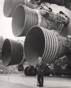 "oldschoolgarage: "" Wernher von Braun stands in front of the F1 engines on the Apollo,circa 1967 """
