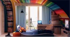 cool rainbow theme for boy with white swivel chair near blue curtain