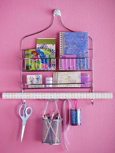 Shower Organizer Mount a low-cost shower caddy to the wall to stash home office supplies, bills, and mail or create gift central (shown here) by storing stationery and wrapping paper. Add ribbon to a wire canister to hang writing utensils from one of the hooks.