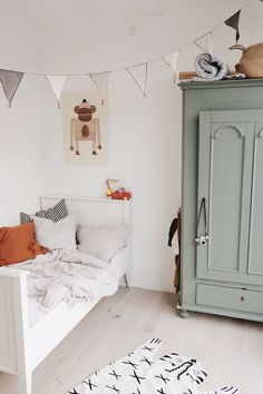 Modern farmhouse boy's room design featuring a green painted armoire, a white wood bed, woven illustrated animal rug, and gray and white banner garland - Unique Nursery Ideas & Children's Room Decor room ideas Painted Armoire, White Armoire, Closet Colors, Boys Room Design, Deco Kids, Vintage Closet, Vintage Wardrobe, Childrens Room Decor, Room Tour