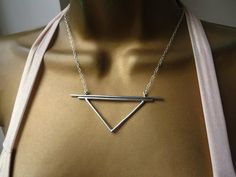 The triangle is rich with symbolism. It can be representative of balance and the unity of body, mind and spirit. With the tip pointing downwards, it represents the alchemic symbol for Earth and is an ancient symbol of the divine power of the feminine. An earthy and receptive power. Symbolic necklace. Symbolism. Earth Symbol. Alchemy Symbol. Pyramid.
