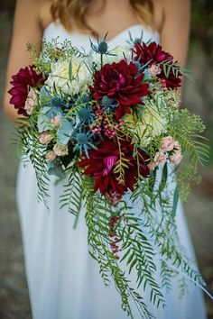 Cascading bouquet with lush greenery and deep red florals. | Photo By: Michelle Peterson Photography