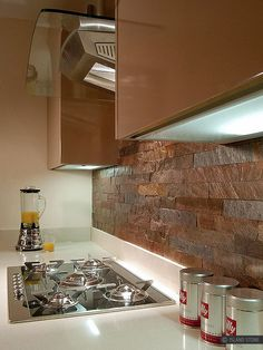 Modern kitchen with copper color slate kitchen backsplash tile from Backsplash.com
