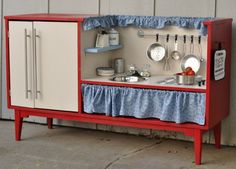 Play kitchens repurposed from old night tables, dressers, etc.  Brilliant!