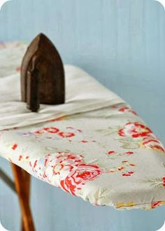 An ironing board cover such as this may even make ironing pleasurable!  Toves Sammensurium