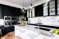 Contemporary Kitchen with electric cooktop, Breakfast bar, double wall oven, Wall Hood, Flat panel cabinets, Kitchen island