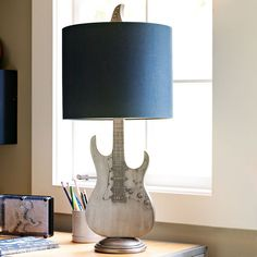 here's a cool looking guitar lamp for the home music room! now we just need an amp lamp. :)