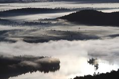 Morning fog shrouds the surface of Bear Pond and the valleys below St. Regis Mountain - Michael Melford